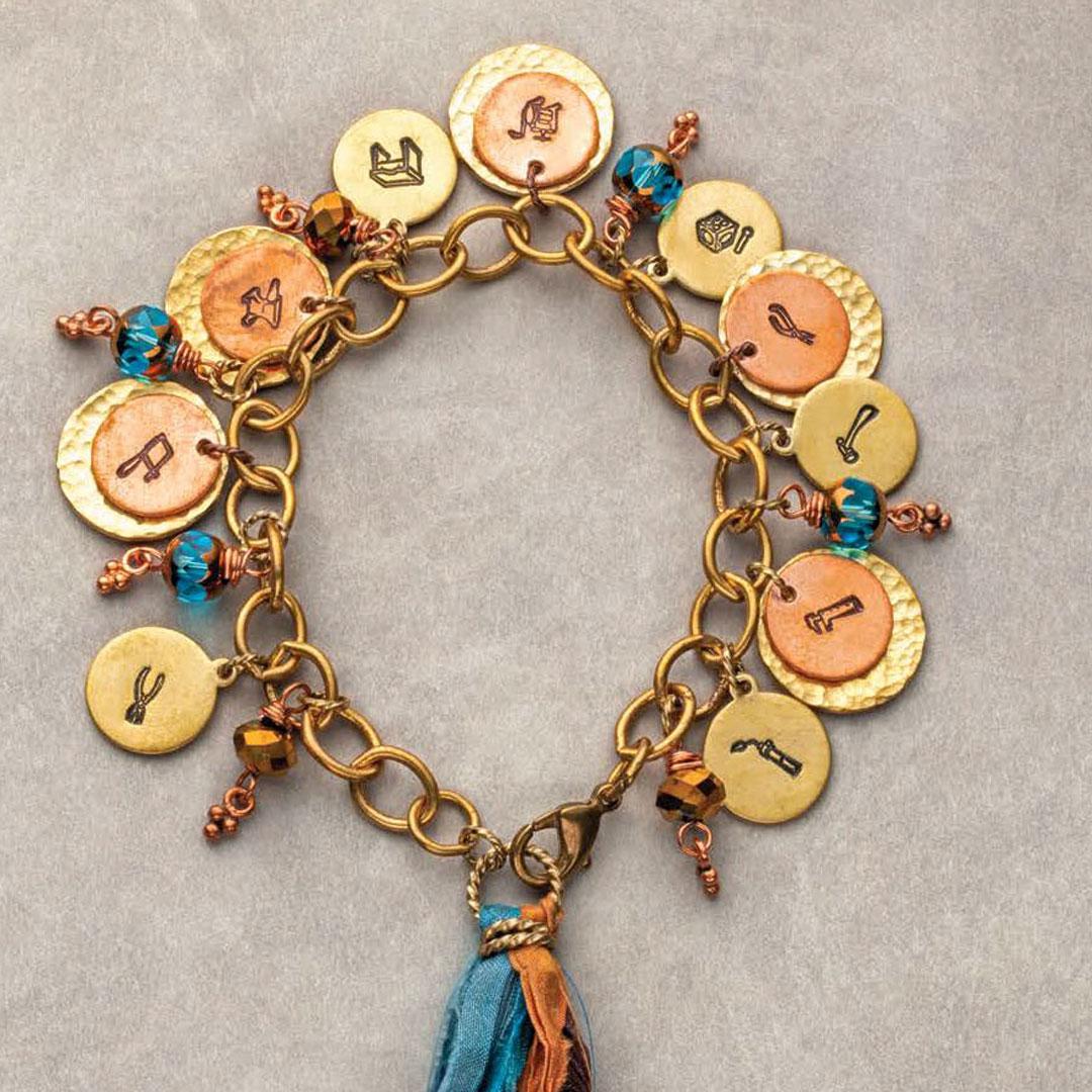 stamped metal jewelry: Rita Pannulla Charming Jewelry Tools Bracelet Brass, copper, Czech glass, silk PHOTO: JIM LAWSON