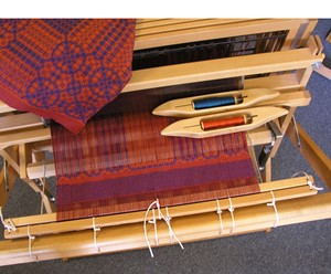 Weaving in a stick is a weaving technique that allows you to cut off a sample, tie your warp back on, and keep weaving!