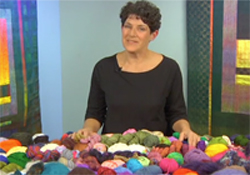 Laura Bryant shows color design with yarn