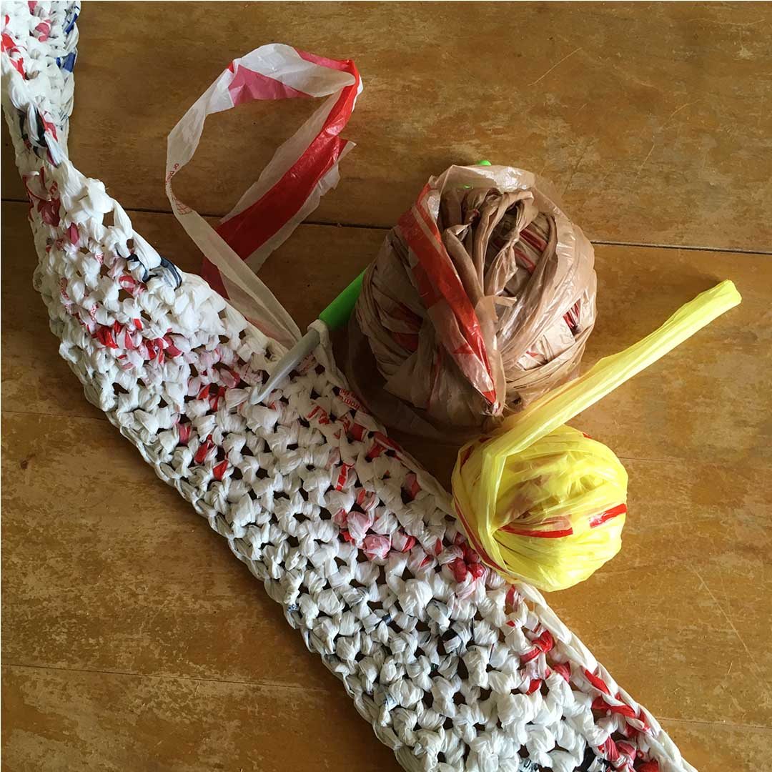 Using yarn from plastic bags to crochet a mat. | Photo Credit: Sara Dudek