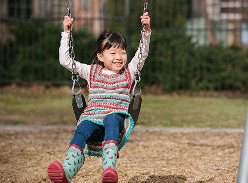 On the Swingset in the Play Day Crochet Dress
