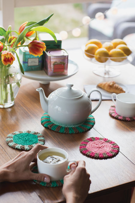You'll love the Promenade Coaster and Trivet Set knitting patterns that include scrap quilt-inspired coasters and trivets and will brighten up a table.
