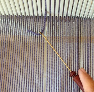 Pull one end of your replacement warp thread through the slot or hole that the broken warp thread was originally in.
