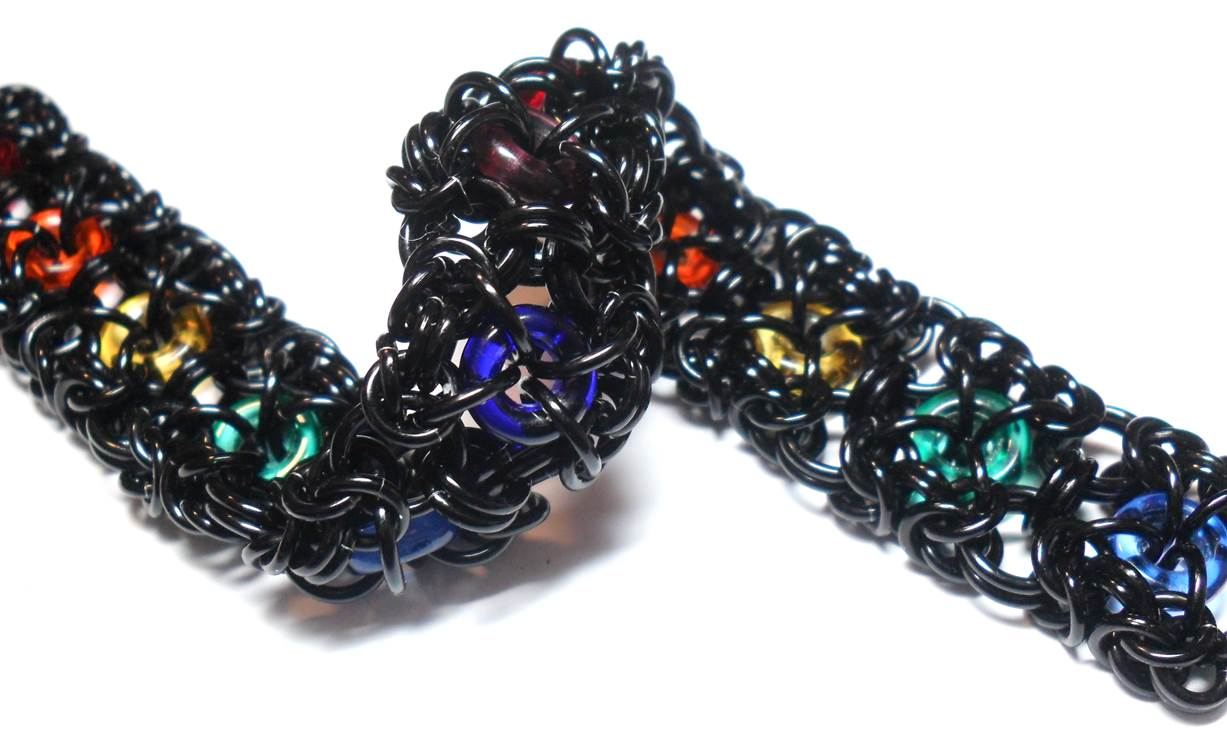 Chain Maille Jewelry Design: It's All About the Unit. For her Rainbow Bridge bracelet, Michelle uses colorful pressed Czech glass beads and anodized aluminum; photo courtesy of the artist.
