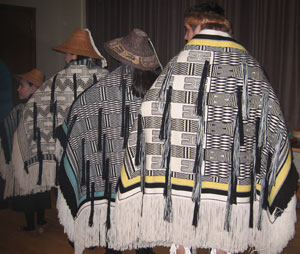 Dancers in ravenstail robes