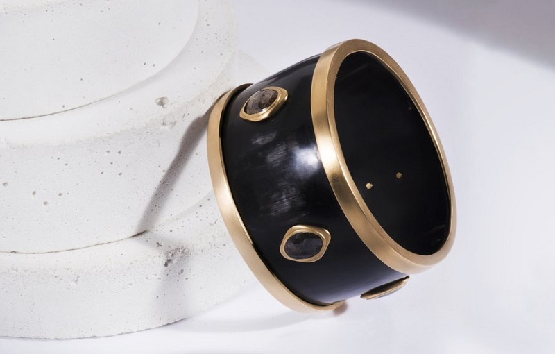 The unusual combination of cow horn and black diamonds set off by 18k yellow gold in this bracelet is indicative of Sandy Leong's bold design style. Courtesy Sandy Leong Jewelry.