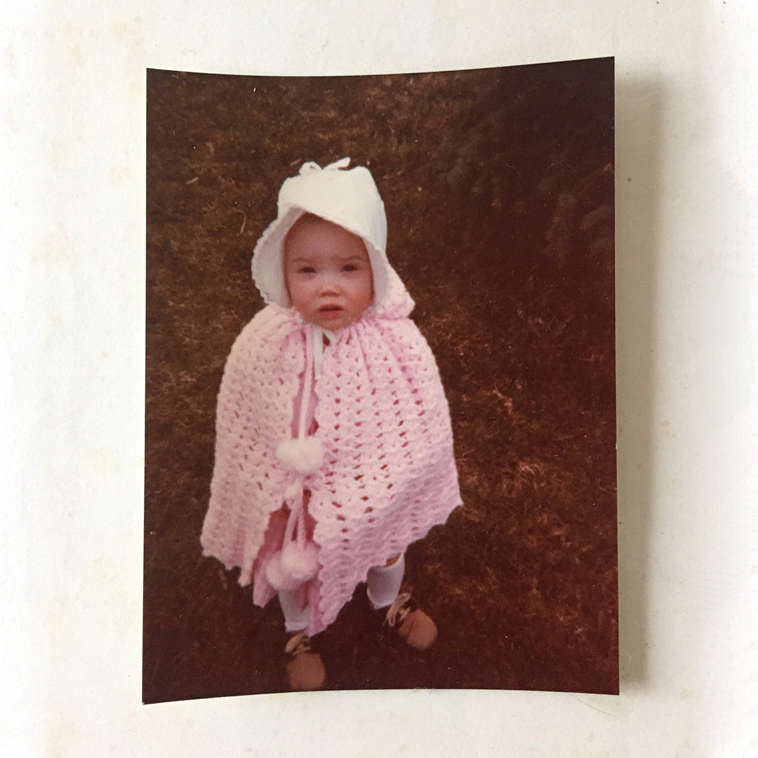 Circa 1979 when I was just over a year old and wearing my crocheted cape. Image © Carol Kester, used with permission.