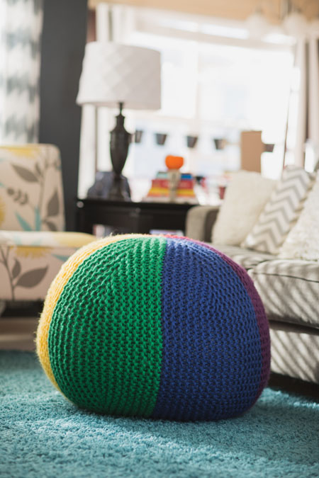 You'll love this knitted home decor project—the Spectrum Pouf, which is a fun and adventurous knitting project with bold colors and large gauges.