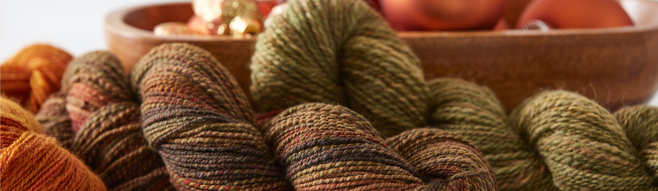 Give the gift of handspun yarn or knitted projects this holiday season!
