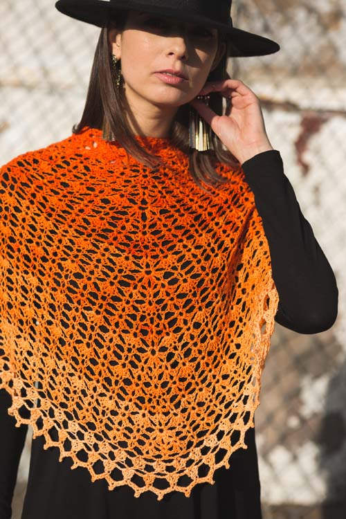 This crochet shawl is stunning with a cluster and picot crochet edging.