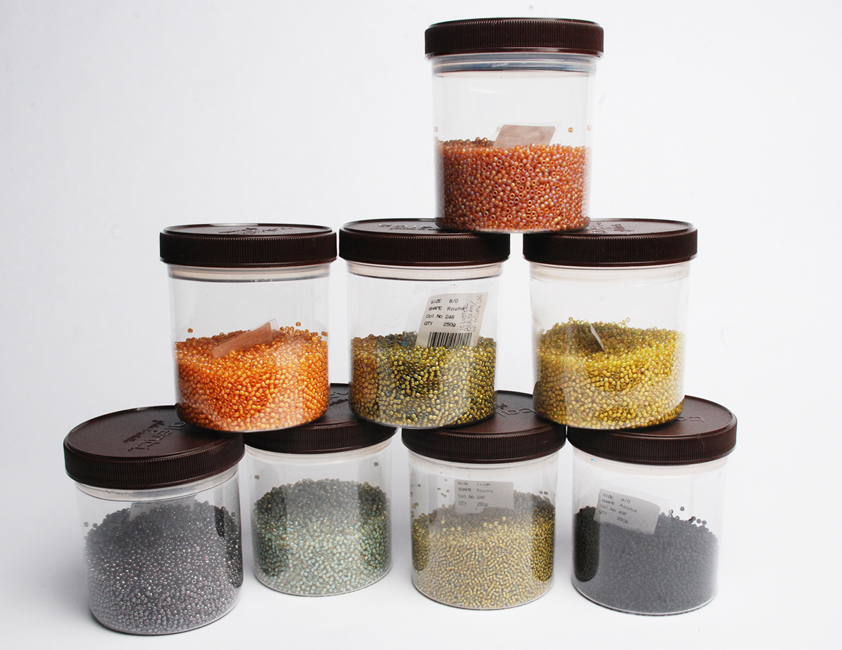 Talenti jars filled with a variety of Toho seed beads