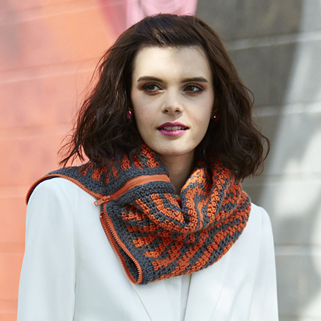Tigre Zippered Cowl in gray and orange. | Photo Credit: George Boe