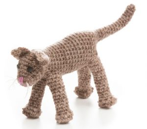 Interweave Crochet Assistant Editor Dana Bincer's interpretation of Weldon's Toy Cat from Weldon's Practical Needlework, Volume 9. Photo by George Boe.