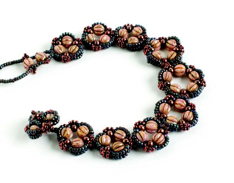 5 Beaded Jewelry Components You Need in Your Arsenal. Trefoil earring components transformed into a beaded bracelet design, by Melinda Barta, beadweaving expert.