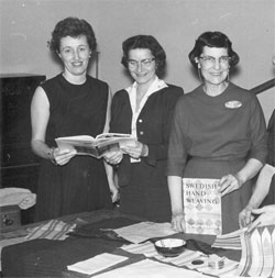 Virgina West and friends showing their handwoven textiles in the 1950s.