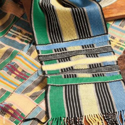 Susan Halvorson's kente cloth inspired scarf photographed with the textile that inspired it.