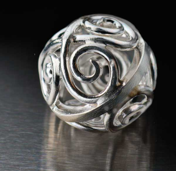 Silver Filigree Bead by Nanz Aalund with José Lins would be the perfect jewelry design to turn into a holiday ornament.