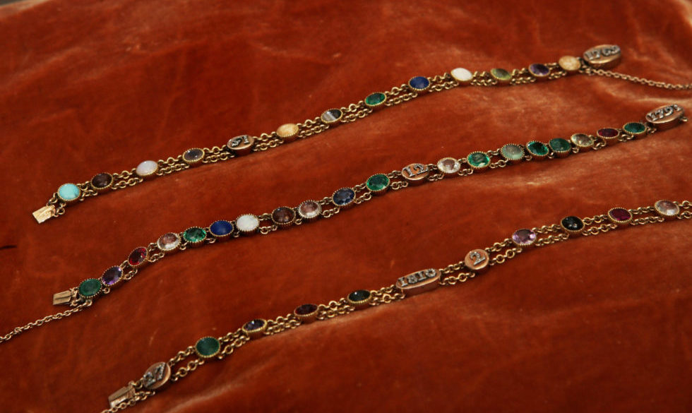 """Acrostic bracelets belonging to the Empress Marie-Louise are displayed by French jewelry house Chaumet during their exhibition ebtitled """"Napoléon in Love"""" at Place Vendôme. These gold chain bracelets are set with stones whose initials spell out the name Napoleon (Natrolite, Amethyst, Peridot, Opal, Lapis lazuli, Emerald, Onyx, Natrolite), his date of birth, August 15th 1769 (Agate, Opal, Uranium, Turquoise), Marie-Louise (Malachite, Amethyst, Ruby, Iris, Emerald), her date of birth December 12th, 1791 (Diamond, Emerald, Chrysoprase, Emerald, Malachite, Beryl, Ruby, Amethyst,) and the dates of their first meeting at Comoiegne on March 27, 1810 (Malachite, Amethyst, Ruby, Serpentine) and wedding in Paris in 1810 (Amethyst, Vermeil, Ruby, Iris, Laboradite). (Photo by Stephane Cardinale/Corbis via Getty Images)"""