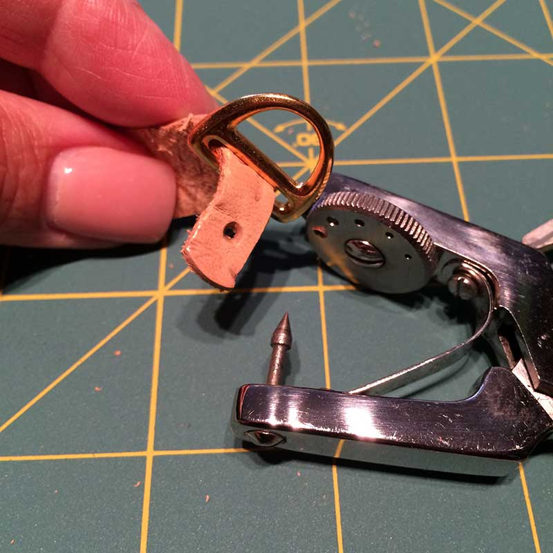 Punch a hole in the end of the embossed leather then add your clasp end.