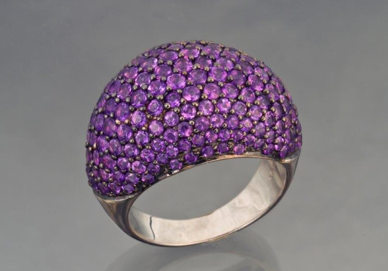 amethyst gemstones: Lots of small stones, pave set across the crown of a ring can give you a wallop of color. The skill needed for setting these stones, however, will raise the price of this piece of jewelry. Photo Mia Dixon, courtesy The Collector Fine Jewelry.
