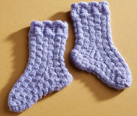 Create these knitted baby socks in this free guide on baby knitting patterns.