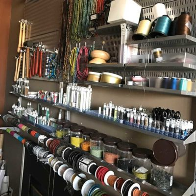 Amazing bead wall in the organized studio space, truly inspiring!