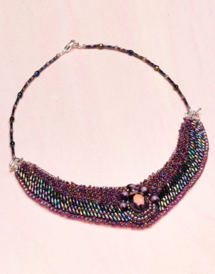 Use seed and bugle beads to bead-embroider this beautiful collar in iridescent hues of the northern lights. It has a unique strap that makes putting it on a breeze and is part of a free beaded necklaces eBook