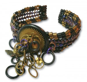 Learn how to make steampunk jewelry, such as this beaded steampunk cuff, in our free ebook.