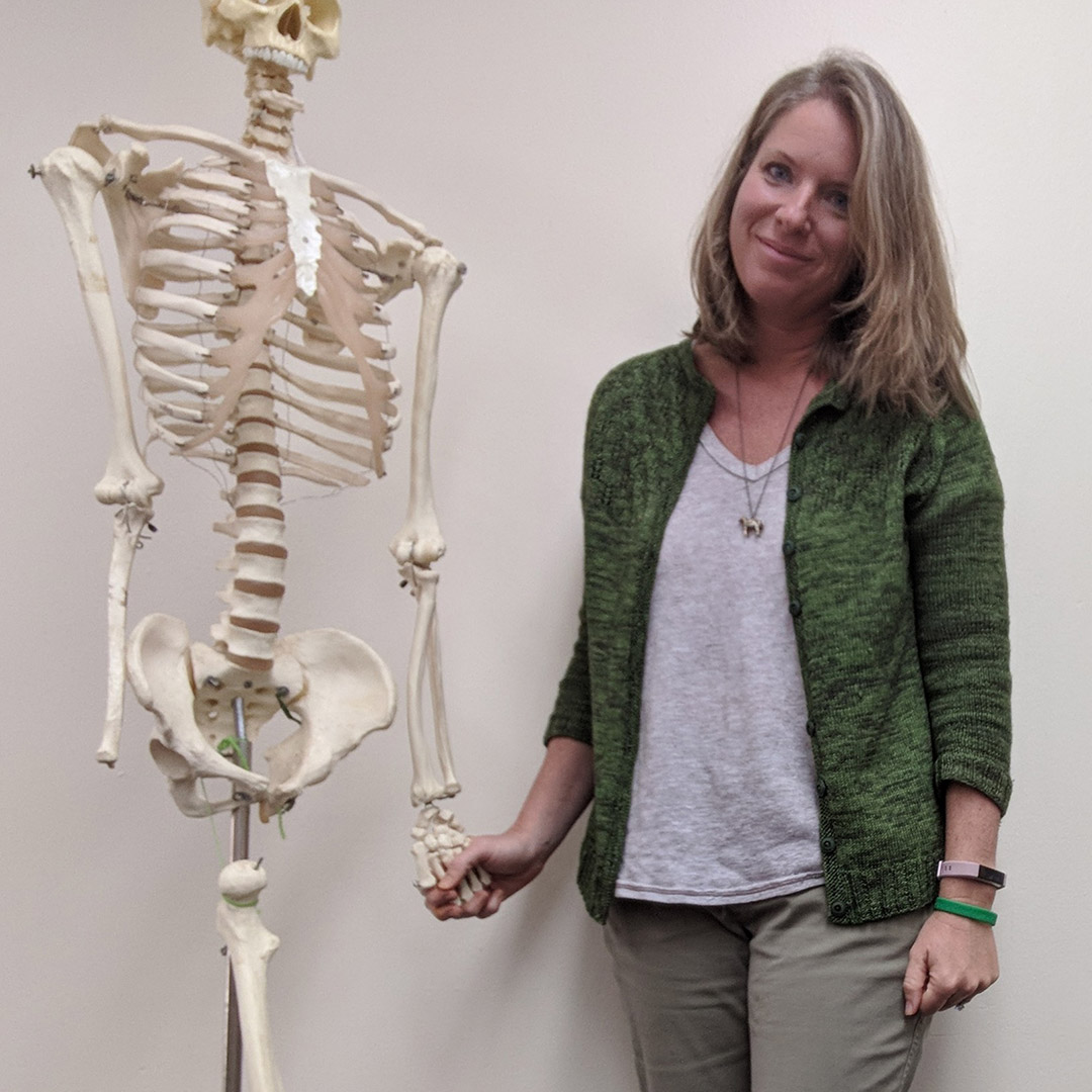 Andrea Cull with the skeleton that lives in her classroom.
