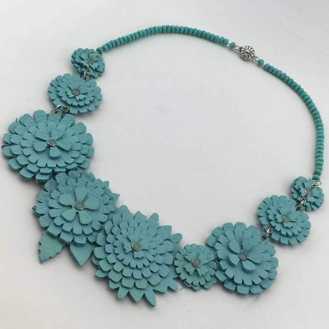 Blossom Bib Necklace with die-cut leather flowers. Photo credit: Jill Mackay