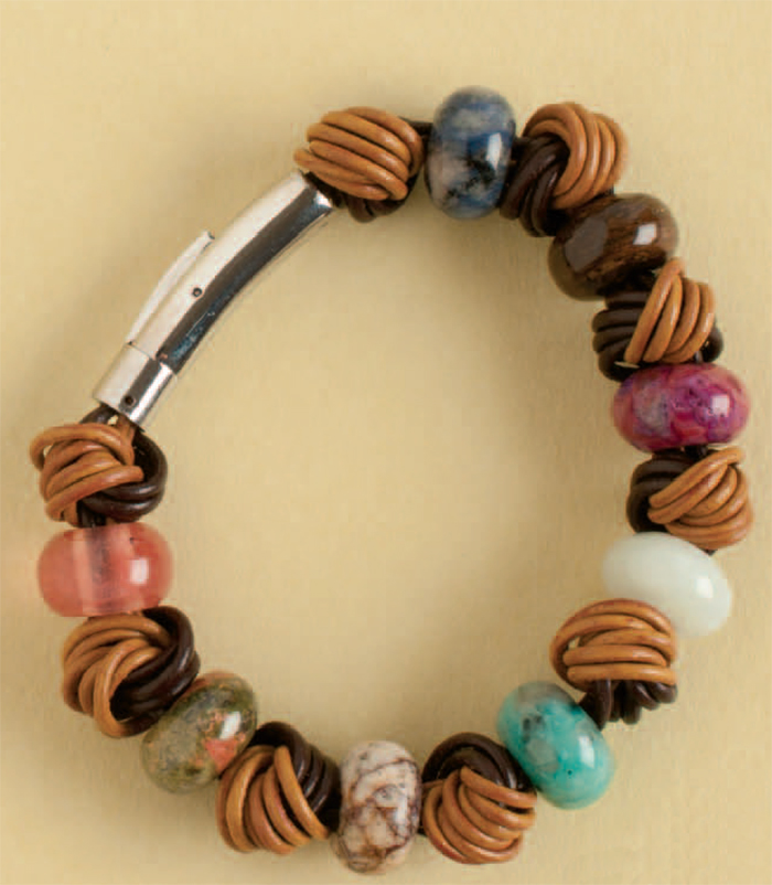 Brazen Knots Bracelet by Deb Huber. Cord ends glued into a claps; snake knots used to create dramatic accents
