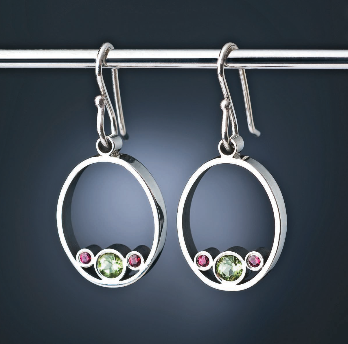 Tube set peridot and ruby add a flash of color to Belle Brooke Barer's silver earrings, in Everyone's Guide to How to Solder Jewelry; photo: Jim Lawson