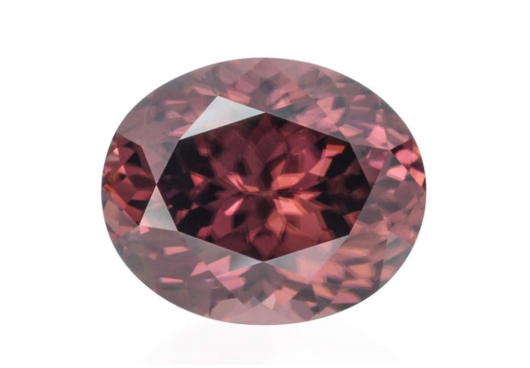 "While true ""pinks"" are hard to find among zircons, the beauty of this warm-colored oval brownish pink zircon is undeniable. Photo courtesy Josh Saltzman, Gems by Nomads."