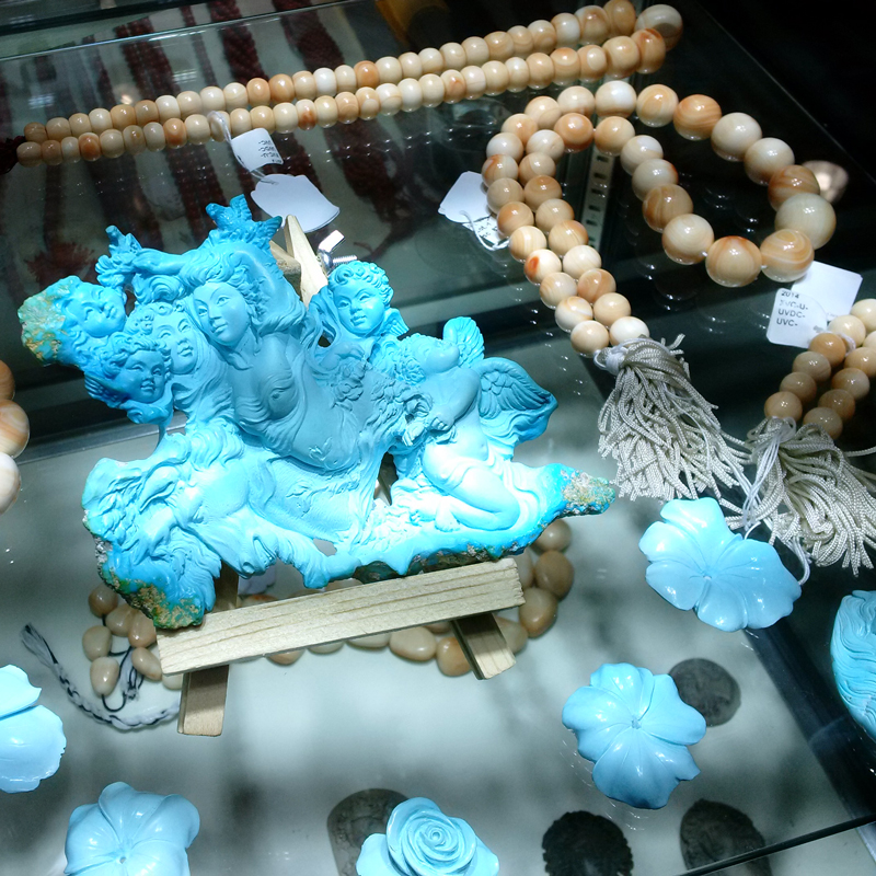 Carved turquoise from Massa Gioconda at the GJX show. February 2017. Photo by Tammy Jones.