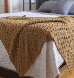 This image is of the Cobblestone Throw by Faith Schmidt. This chunky knitted blanket pattern can be found in our free Chunky Knits eBook.