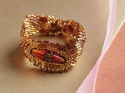 Learn how to make this circular brick stitch bracelet pattern.