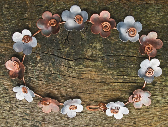 Learn how to make this copper and aluminum necklace with this free eBook on cold connection jewelry making.