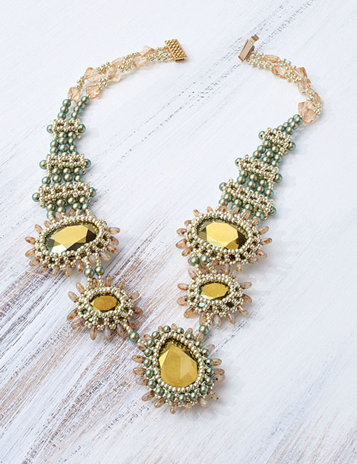 Corona necklace design by Jean Cox. Tubular right-angle weave, cubic right-angle weave, and a touch of circular peyote