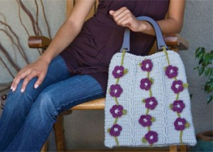The Flower and Vines Bag is a crochet cable stitch pattern found in our free Crochet Cable Stitch Guide eBook.