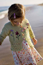 The Sweetpea Cardigan is a free crochet pattern for kids found in our free eBook that features floral stitching.