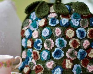The Flowered Tea Cozy is a flower covered tea cozy crochet pattern found in our free Crochet Home Decor Patterns eBook.