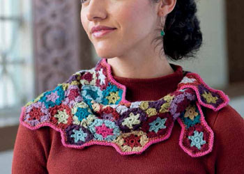 Learn how to crochet this scarf with granny squares in our free eBook on how to make a granny square and patterns.