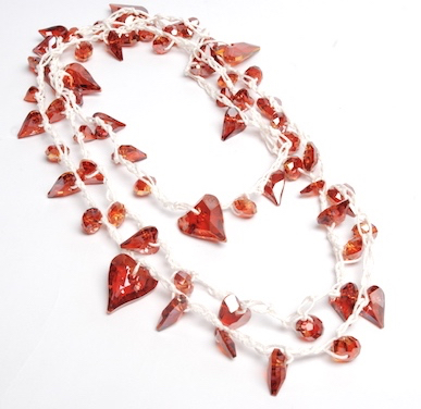 Swarovski Wild Heart bead crochet necklace. White hemp cording, 5mm crochet hook, Swarovski crystals in crystal red magma