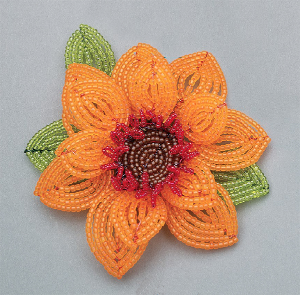 Daisy pin by Maryann Patterson-Curls, French beaded flower technique.