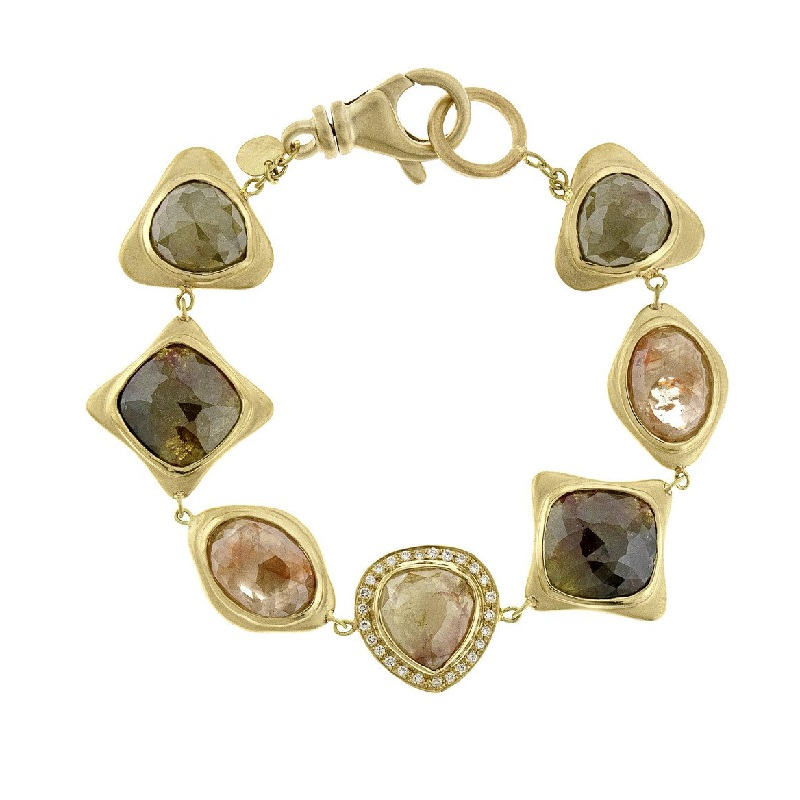 This 18k yellow gold bracelet by Sandy Leong shows off the variety of color, shape, and texture that is possible with diamonds once thought unusable for jewelry. Courtesy Sandy Leong Jewelry.