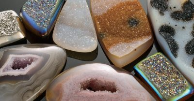 drusy gemstones: This is another selection of drusy. The shapes with the metallic glittery look are coated with titanium. Photo by Jim Lawson.