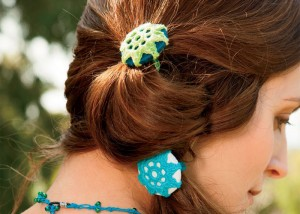 Learn how to make these crochet flowers to hold up your hair in a ponytail in this FREE eBook.