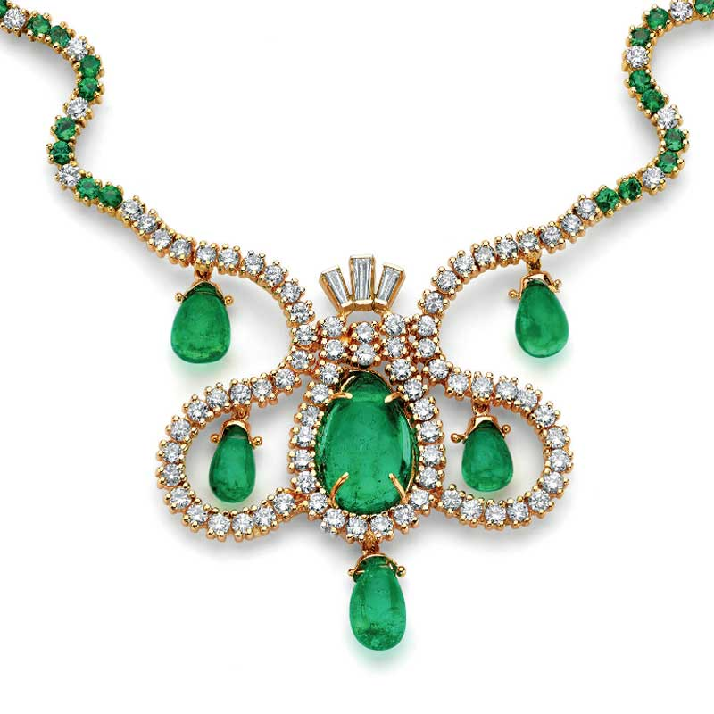 "Part of Manuel Marcial de Gomar's emerald collection, The Empress of Spain Necklace includes a 9.48ct. teardrop emerald, five briolette teardrop emeralds (12.76 cts), cat's-eye emeralds (2.03 cts.), round brilliant tapered baguette diamonds, and 18K and 14K gold. The man and his collection are featured in ""Emerald Encounters."""