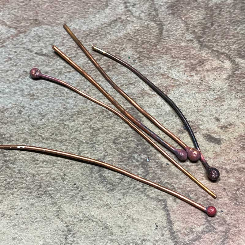 From copper wire into ball tip headpins.