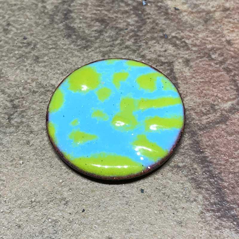 Finished sample of enamel stenciled onto metal.